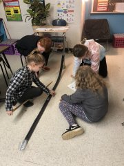 Mrs. Hassell's class testing potential and kinetic energy by creating a roller coaster