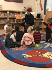 Officer Rieger reading Halloween Safety to PreK